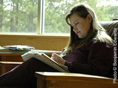 Student Reading in Campus Library