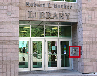 Book return at Barber Library, to the right of the front doors