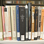 Photo of books in the Barber Library stacks
