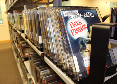 Photo of DVDs in the AV section of Barber Library