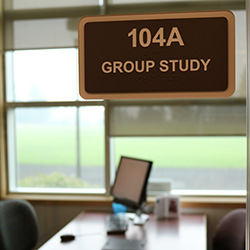 Photo of a group study room on the first floor of Barber Library