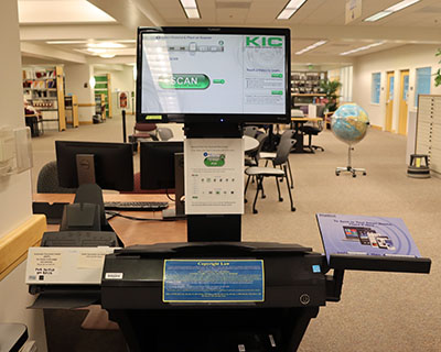 KIC scanner by the Reference Desk in Barber Library