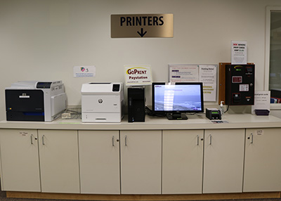 Print station by the reference desk in Barber Library