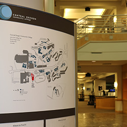 Photo of the Barber Library rotunda with a campus map