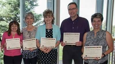 Photo of COCC employees receiving an award